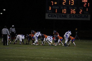 CHECK THAT SCORE BOARD As Ladue's defensive line matches up against long time rival Clayton, the players prepare to rush the quarterback. The Rams emerged victorious, earning a 46-21 thrashing of the hated Greyhounds. The win boosted Ladue's record to 6-3.