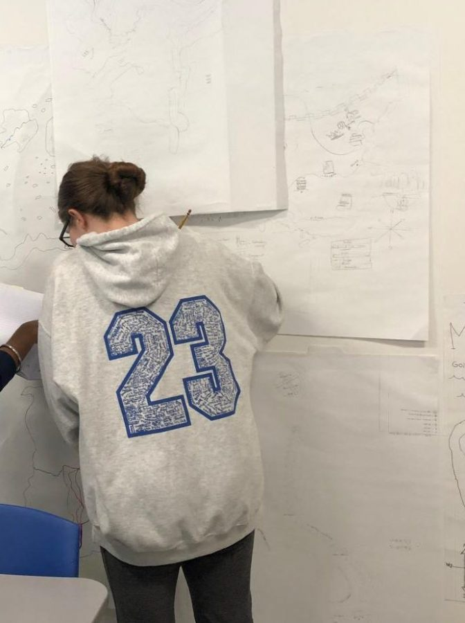 Alexis Monsey (9) works on her map during freshman World Studies. The class was learning about the eight specific features of civilizations.