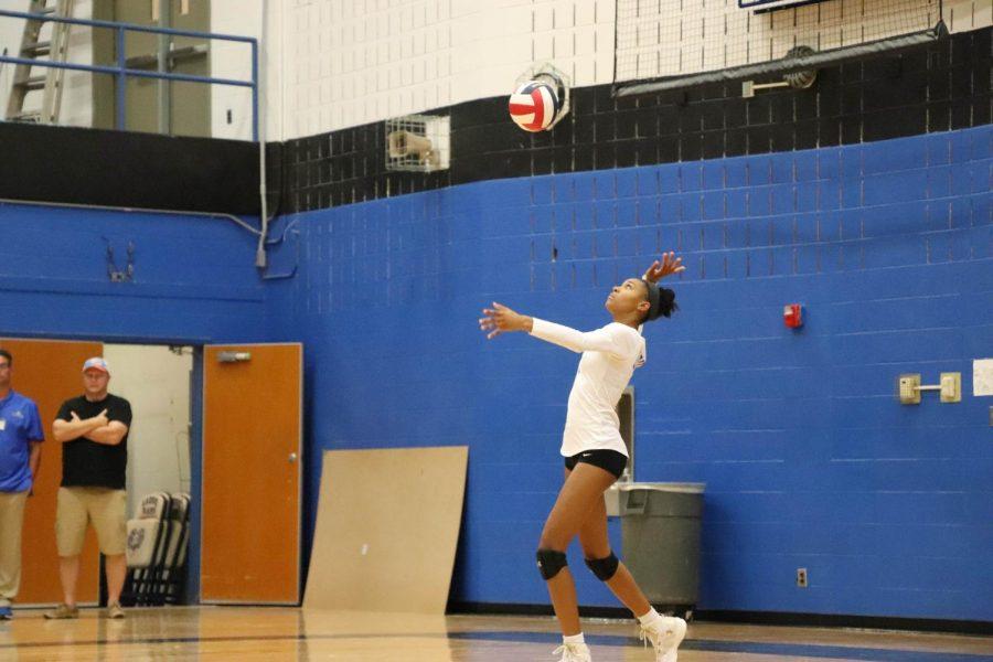 Senior Kyndia Smith serves the ball.