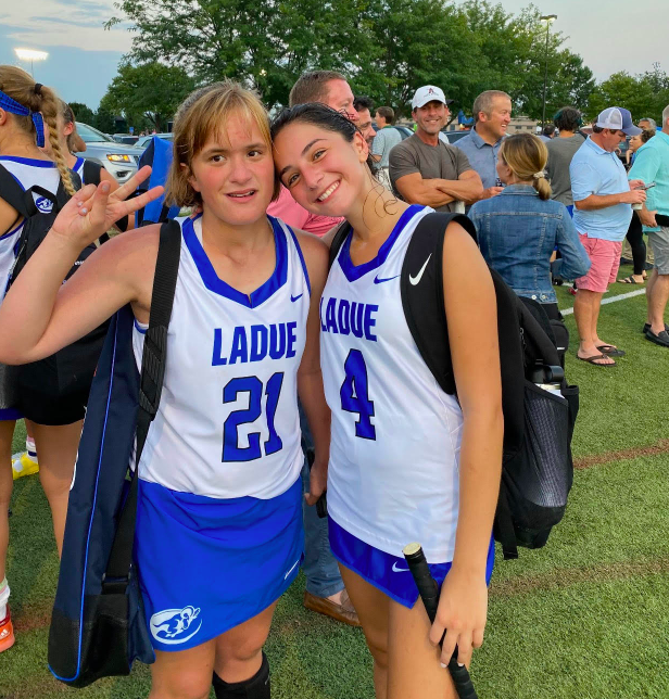 Seniors Julia Tullman (right) and Molly Katzman (left) pose after a game.