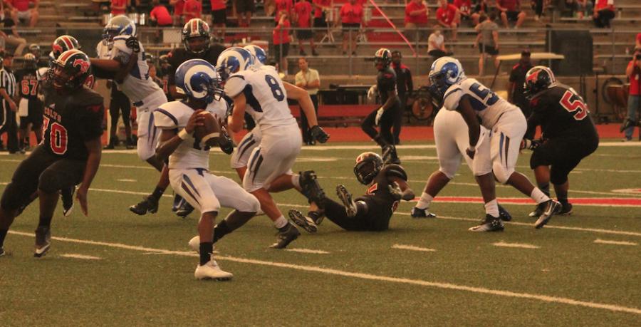 Quarterback Jordan Jackson looks deep downfield for an open receiver.