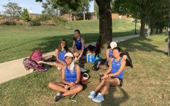 JV Girls take a break under the tree between their matches.