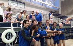 Swim and Dive seniors pose alongside their parents. From left to right: Anthony Wang, Maddoc McGowan, Grant Cox, Rohan Tatikonda, Ben King, Henry Naismith and Cade Vetter. Being held up is James Ramey.