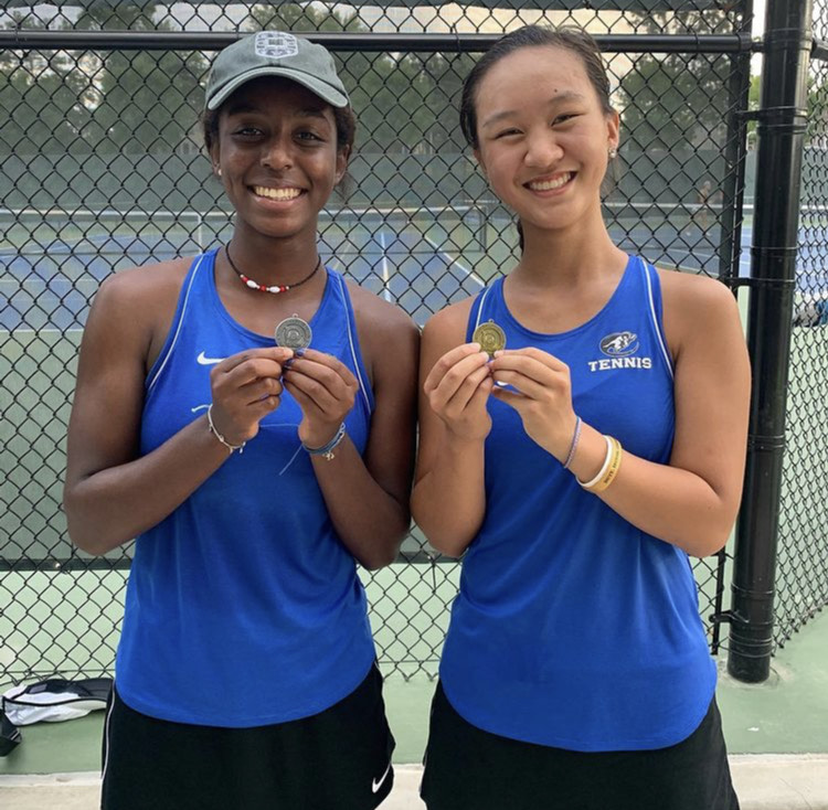 """Saba Fajors and Megan Ouyang smile for a picture after qualifying to state. The girls are the number one and number two on the varsity tennis team. """"I am very excited for state and to see how the competition is like,"""" Fajors said. """"I just want to win a match. It's going to be awesome."""""""